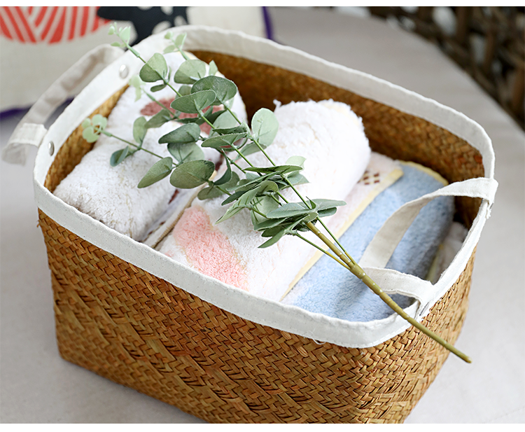 Straw woven basket with cloth handles